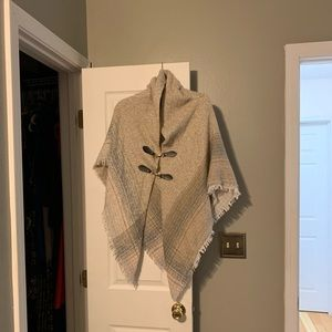 Beige with light pink and blue poncho